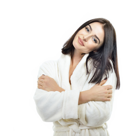 Portrait of beautiful woman in soft beige bathrobe