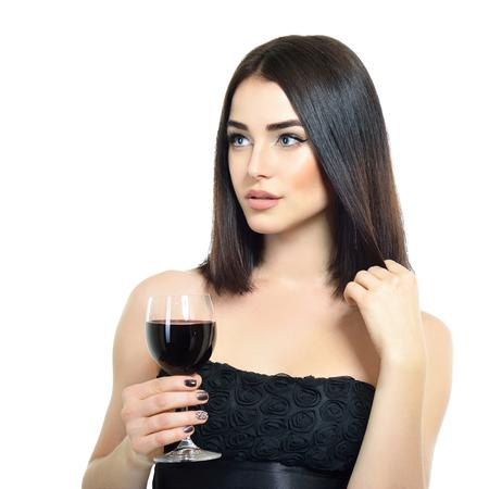 白い背景の上のワインのグラスと美しい若い女性の肖像画 写真素材