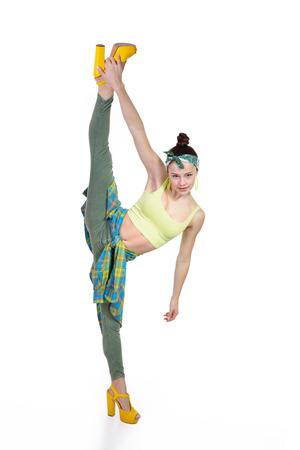 splits: Attractive slim teen girl posing in studio. Full length portrait of young fashion woman. Fitness dancing girl. Splits. Stock Photo