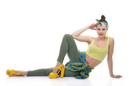 Attractive slim teen girl posing in studio. Full length portrait of young fashion woman. Fitness dancing girl. photo