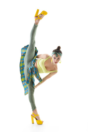 Attractive slim teen girl posing in studio. Full length portrait of young fashion woman. Fitness dancing girl. Splits. photo