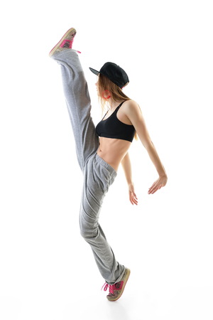 Teen girl hip-hop dancer over white background. Step. photo