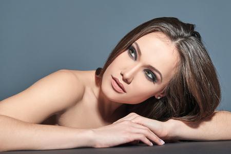 heartbreaker: Fashionable woman. Beautiful female face. Woman of high society. Heartbreaker. Beauty woman. Portrait of amazing young fashion woman posing at studio.