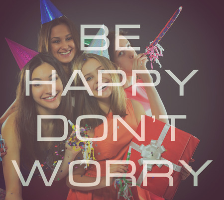 hedonistic: Joyful happy smiling teen girls have fun on birthday party, over black. Be happy, dont worry Stock Photo