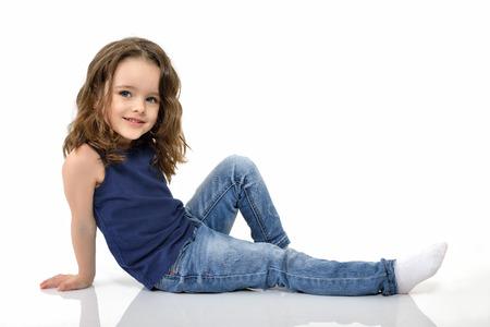 cute little girl: Sweet little girl, studio portrait over white background Stock Photo