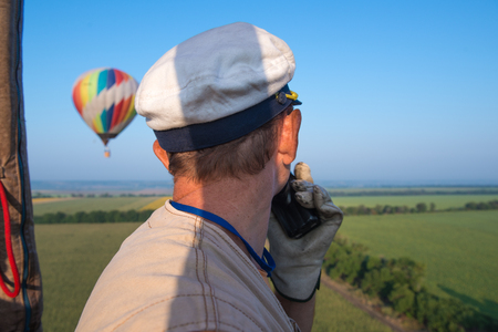 Aeronautics. The pilot balloon. View from the balloons basket. Amazing view from the height of the balloon. Summer beautiful fields lanscape from the birds eye, sunrise. Ballooning.
