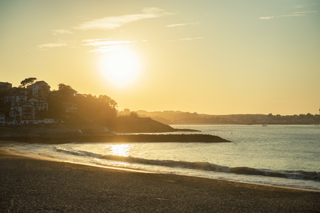 serene landscape: Beautiful sunset in Saint Jean de Luz, France. Panoramic view of calm serene ocaen coast landscape of luxury french resort Saint-Jean-de-Luz.