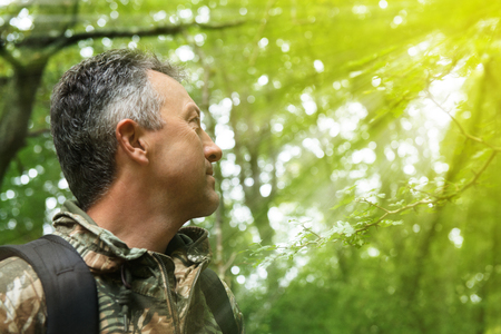 manful: Outdoor autumn male portrait. Handsome middle-aged man posing in forest, image toned and noise added. Stock Photo