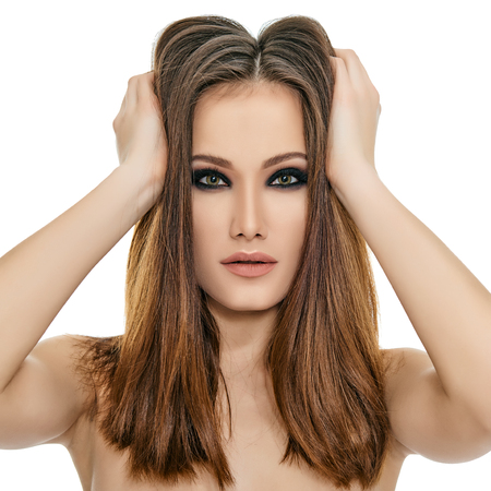 Majestic woman's beauty. Portrait of beautiful girl with healthy skin and strong brown long hair over white background. Beauty treatment, cosmetology, spa, health care, body and skin care concept. photo