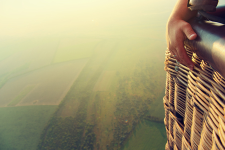 View from the balloons basket. Amazing view from the height of the balloon. Summer beautiful fields lanscape from the birds eye, sunrise. Ballooning. 版權商用圖片