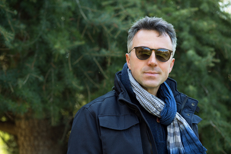 manful: Handsome man. Outdoor winter male portrait. Attractive confident middle-aged man in sunglasses. Stock Photo