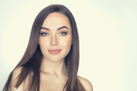 Beautiful female face closeup. Attractive girls portrait, image toned. Stock Photo