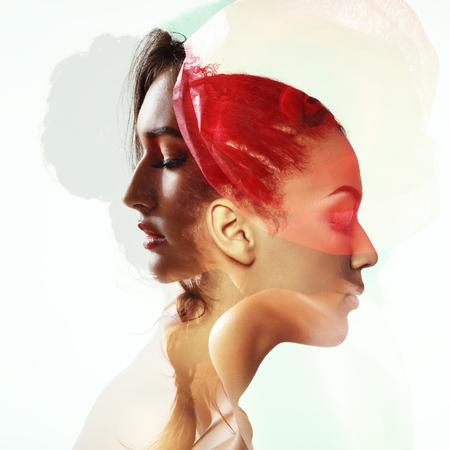 Double exposure portrait of two beautiful fashion girls. Young women in love. photo