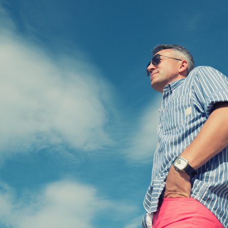 Handsome man. Outdoor male portrait. Middle-aged man, summer outdoor portrait over sky, image toned. Stock Photo
