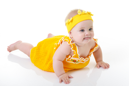 Adorable baby girl posing and happy smiling in studio short over white background. Portrait of cute child. Beautiful little girl.