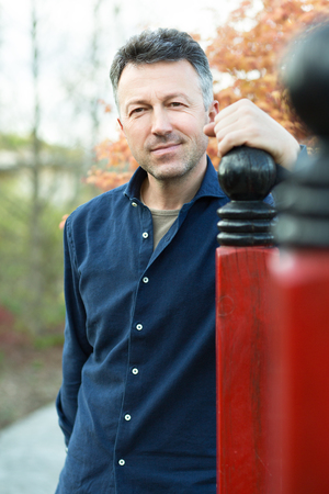 manful: Portrait of handsome man posing in spring Japanese garden