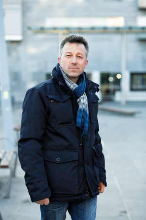 manful: Handsome man. Outdoor winter european male portrait. Attractive confident middle-aged man, city portrait, image toned. Stock Photo
