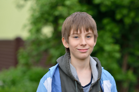 Boy. Outdoor portrait of 11 years old teenager. Handsome young boy. Childs portrait. Stock Photo