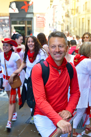 navarra: People celebrate San Fermin festival in traditional white abd red clothing with red necktie, 06 July 2016, Pamplona, Navarra, Spain.