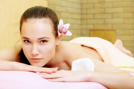 Body care. Beautiful young woman relaxing  at beauty spa salon.  Stock Photo