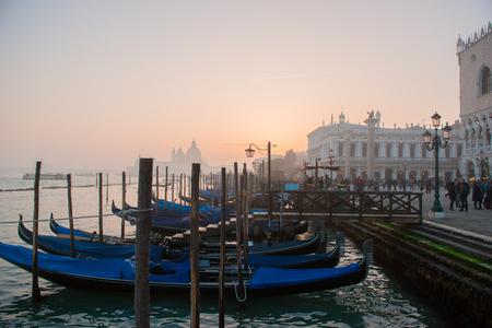 Grand Ð¡hannel with gondolas at sunset, Venice, Italy. Beautiful ancient romantic italian city.