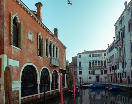 Сhannel with boats in Venice, Italy. Beautiful romantic italian city.