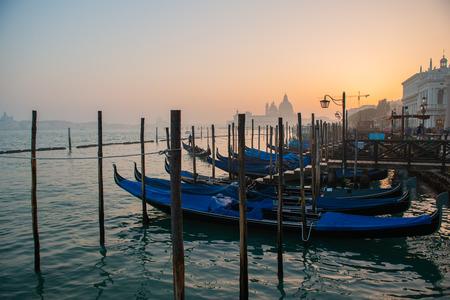 Grand Сhannel with gondolas at sunset, Venice, Italy. Beautiful ancient romantic italian city. Stock Photo