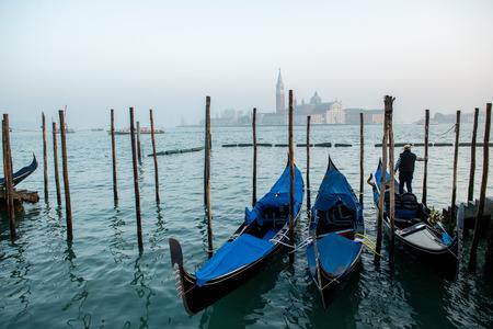Grand Сhannel with gondola and gondolier, Venice, Italy. Beautiful ancient romantic italian city. Stock Photo