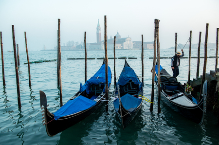 Grand Сhannel with gondola and gondolier, Venice, Italy. Beautiful ancient romantic italian city. Stock Photo - 123618026