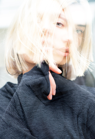Double exposure outdoor female portrait. Fashion model. Portrait of young woman. Beautiful caucasian girl with blond hair. Stock Photo