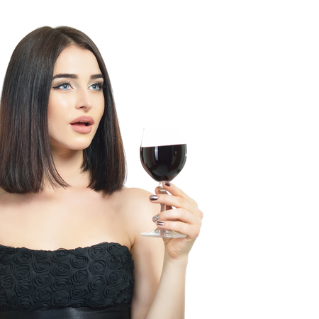 Young attractive woman holding glass of red wine. Pretty lady drinks alcoholic drink Stock Photo - 123014072