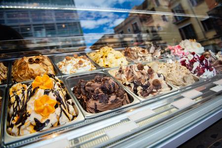 Ice cream in Rome, Italy. Italian gelateria. Ice-cream cafe, show window with sweeties. 写真素材