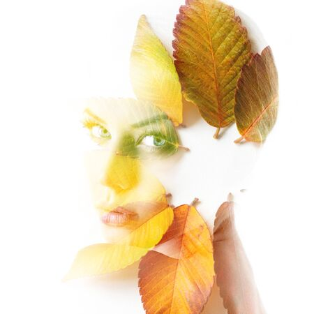 Double exposure portrait of beautiful young woman and fall leaves isolated on white background. Autumn season concept