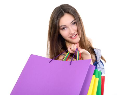 Beautiful happy girl shopaholic with colored shopping bags, over white. Seasonal sale