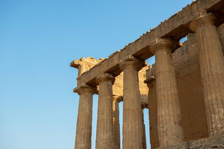 Valley of the Temples (Valle dei Templi), an ancient Greek Temple built in the 5th century BC, Agrigento, Sicily. Famous tourist attraction in Italy. Old marble columns of the Doric order. Travel destination Imagens