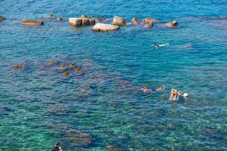 Tourists swimming in sea, top view. Beach in Sicily, Italy. Foto de archivo