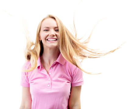 Happy smiling excited comical surprised young charming woman with long flying blond hair over white background.