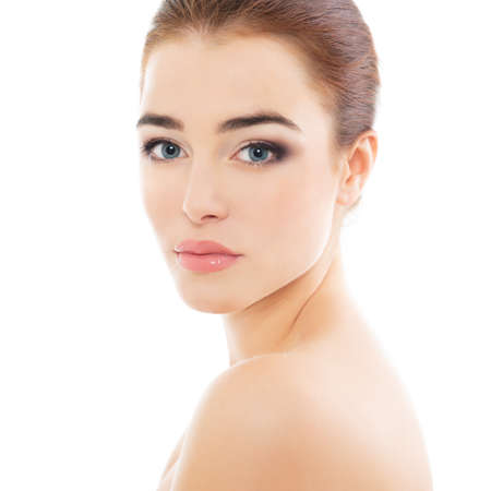 Portrait of beautiful calm woman with young clean healthy skin, studio shot isolated on white background. Anti-aging and beauty treatment. Foto de archivo