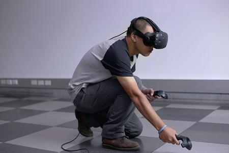 Men steps into virtual reality world with virtual glasses eyewear htc vive