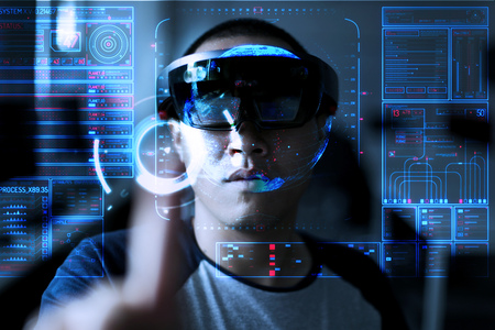 Men steps into virtual reality world with microsoft hololens 1
