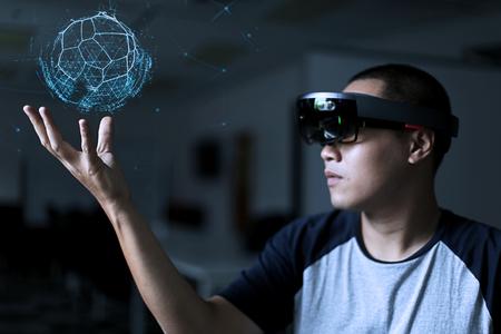 Men playing virtual reality world with microsoft hololens 1