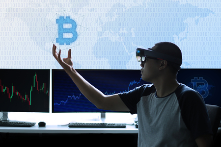 Experience Virtual Reality world with hololens 1 | Control Bitcoin currency in hand Banco de Imagens