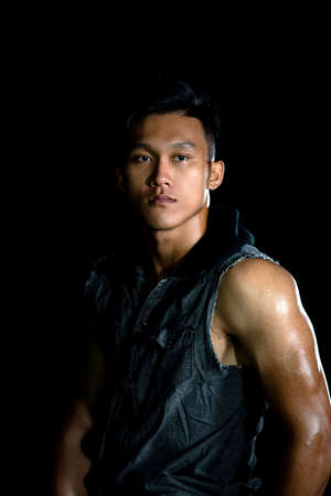 Asian muscle men posing muscle six abs on the black background | Asian Sexy Men fashion