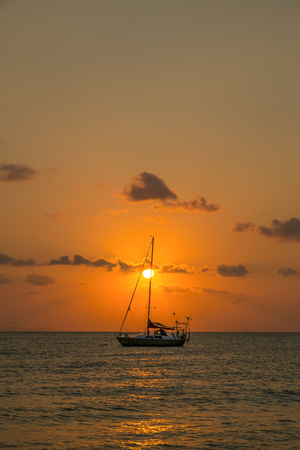 Sunset with sailing boat