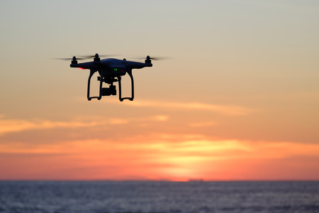 Drone flying at the sunset moment Stock Photo