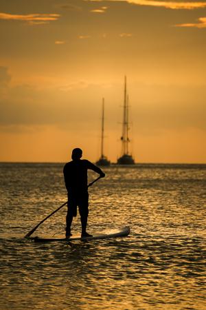 man with the paddle sailing at sea