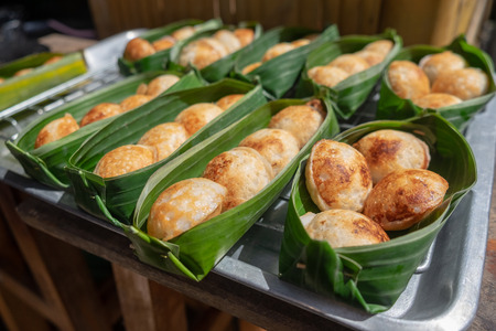 Thai sweetmeat khanomkhrok banana leaf package