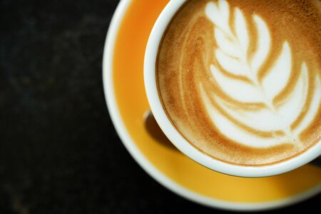Coffee Latte leaf pattern face on black table