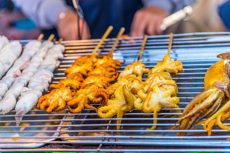 Grilled Squid at street food in thailand