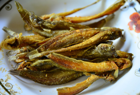 Fresh fried european anchovy on a white plate Stock Photo